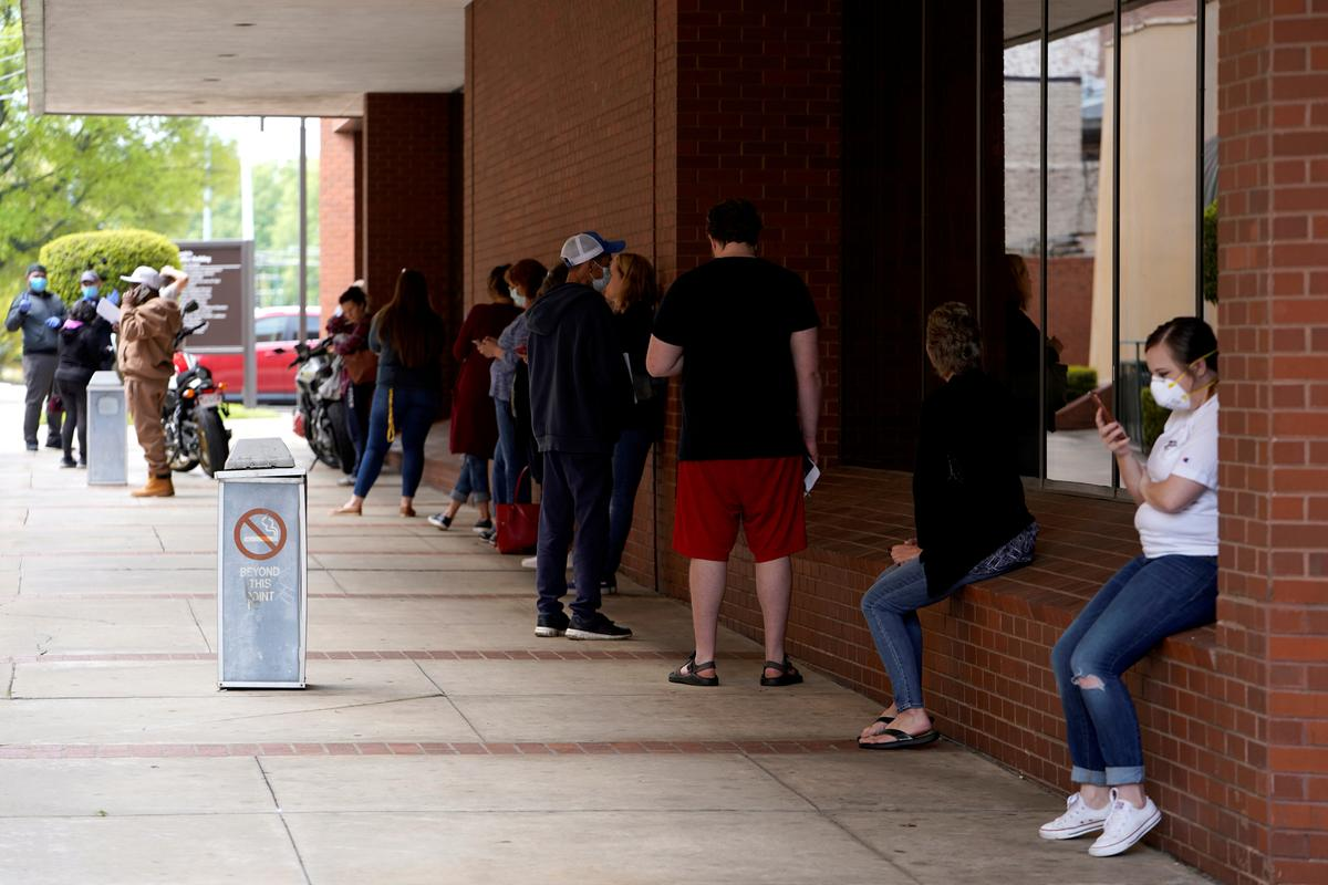 Millions of Americans continue to seek jobless benefits; consumer spending slumps