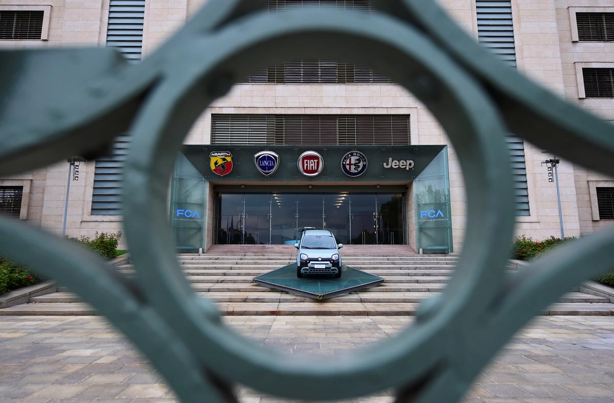 Fiat Chrysler plunges to loss, but no change to PSA deal