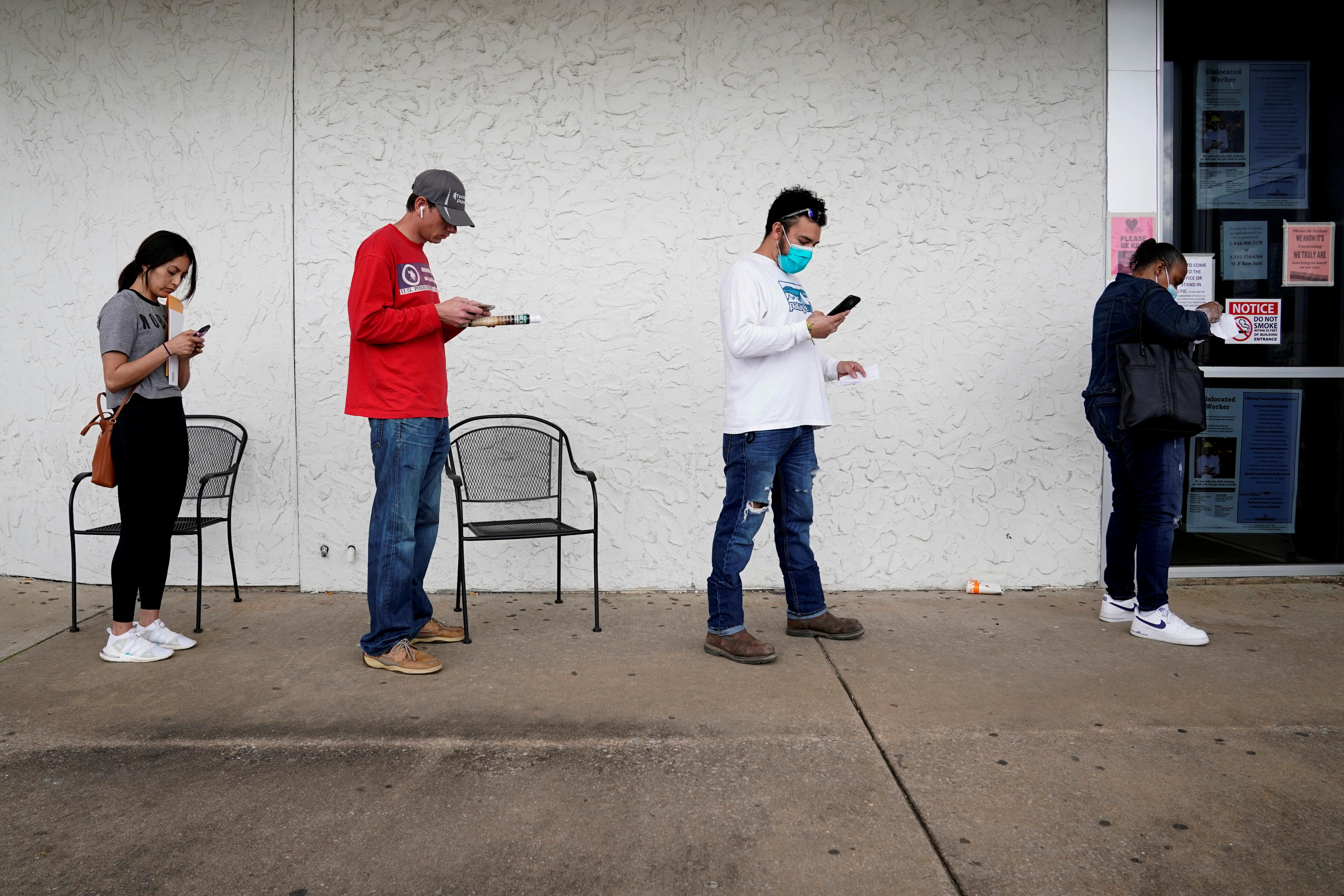 Millions more Americans seek jobless benefits; productivity dives