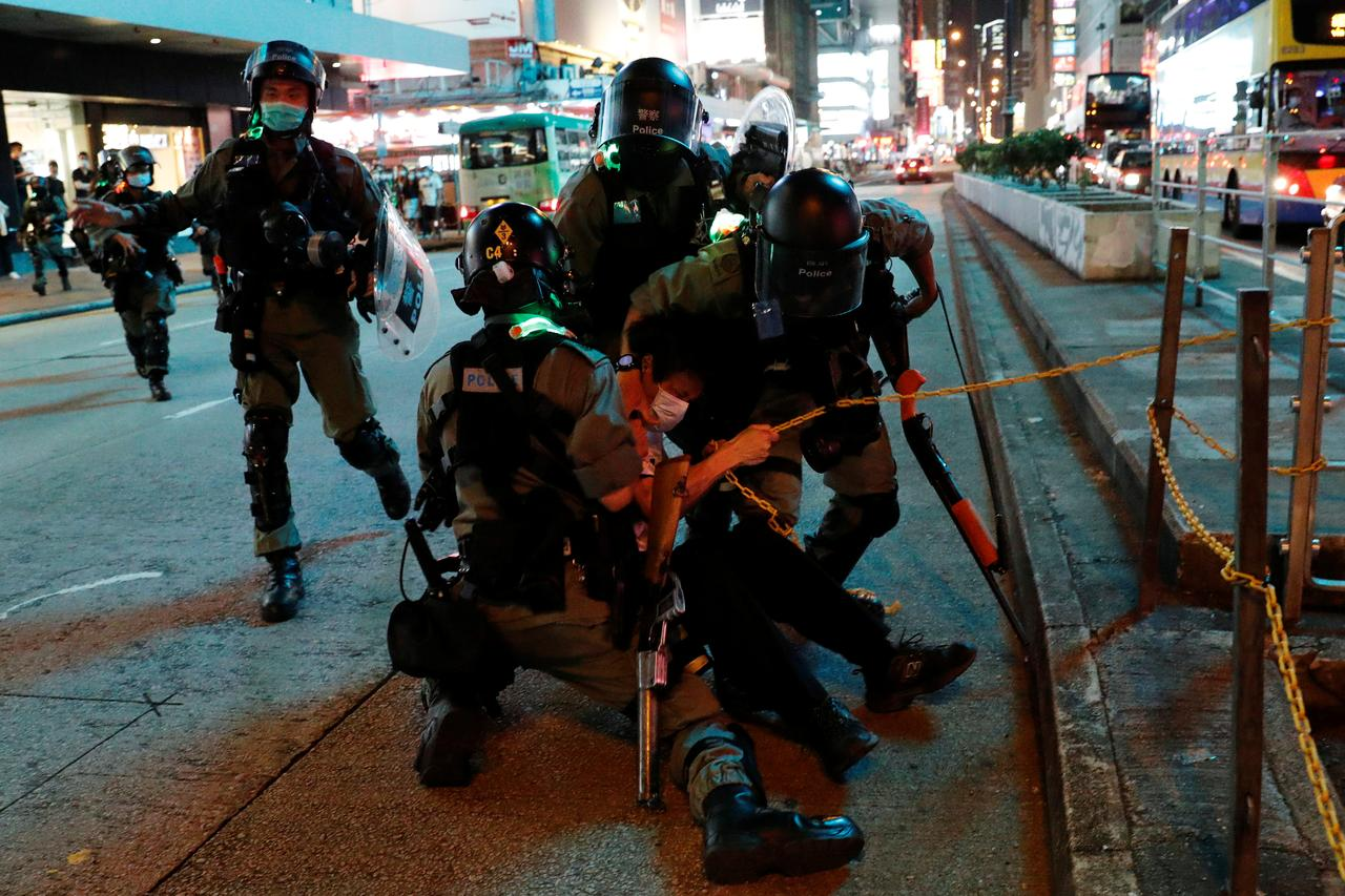Hong Kong police arrest more than 200 as pro-democracy protests ...