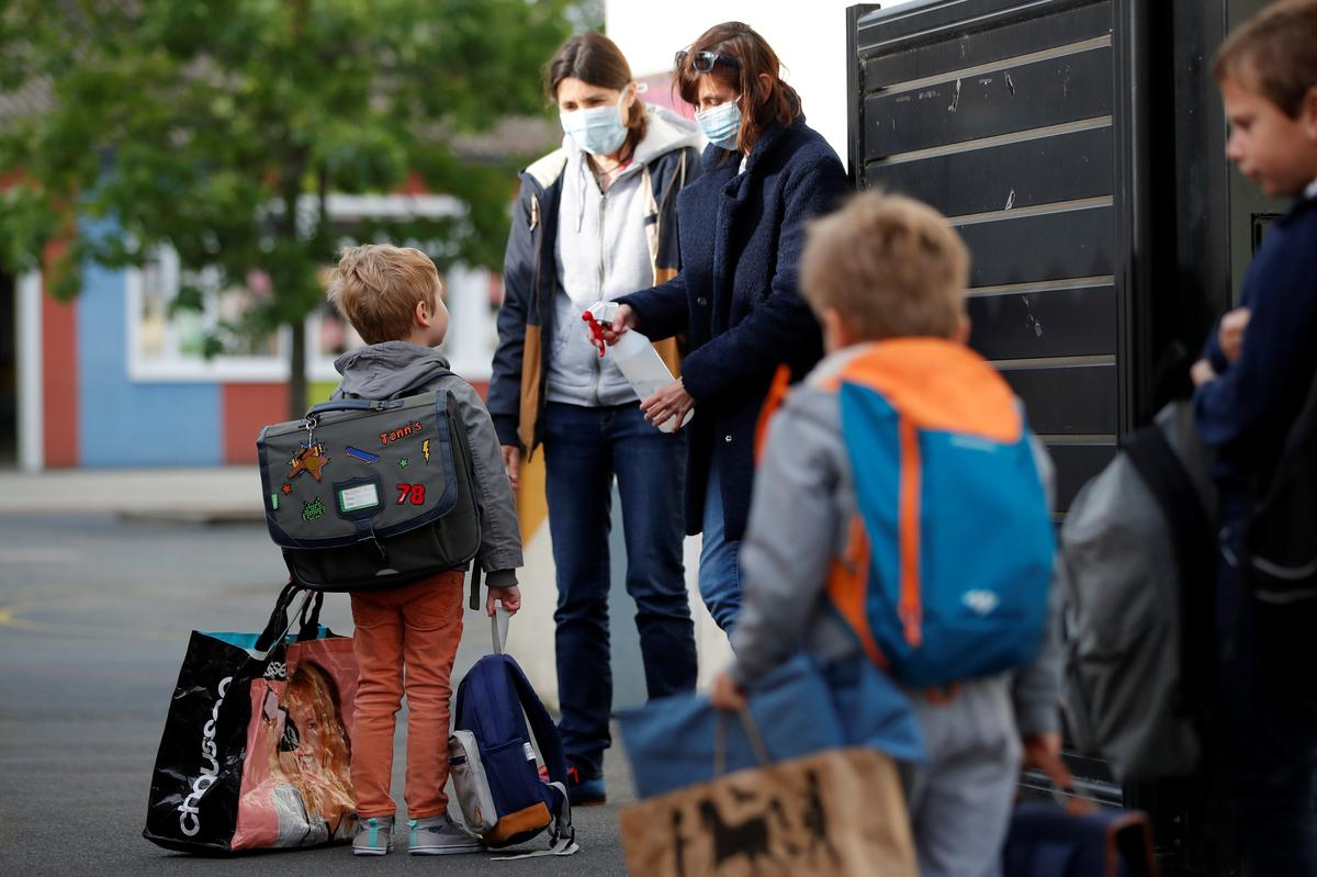 French primary pupils trickle back to class after eight-week lockdown