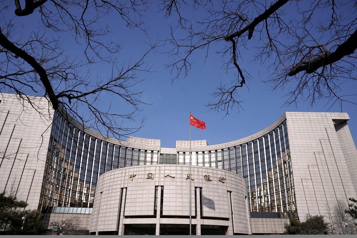 China central bank should shun risky bond buying as economy improves: adviser