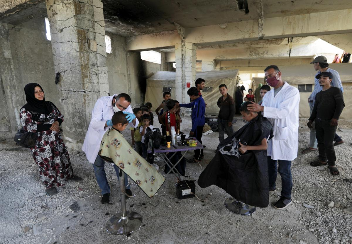 In Syria's war-torn Idlib, travelling barbers bring children relief