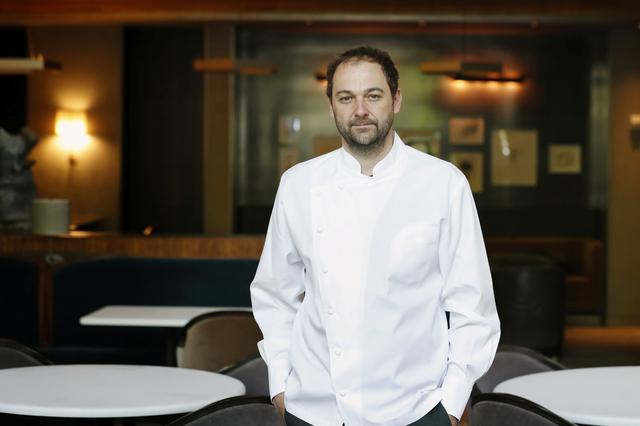 Chef and owner Daniel Humm poses in the shuttered dining room of Michelin starred restaurant Eleven Madison Park as the outbreak of the coronavirus disease (COVID19) continues in the Manhattan borough of New York, U.S., May 20, 2020.  Picture taken May 20, 2020. REUTERS/Lucas Jackson