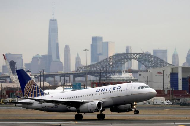 FILE PHOTO: A United Airlines passenger jet takes off with New York City as a backdrop, at Newark Liberty International Airport, New Jersey, U.S. December 6, 2019. REUTERS/Chris Helgren/File Photo