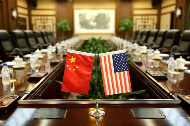 FILE PHOTO: Flags of U.S. and China are placed for a meeting between Secretary of Agriculture Sonny Perdue and China's Minister of Agriculture Han Changfu at the Ministry of Agriculture in Beijing, China June 30, 2017. REUTERS/Jason Lee