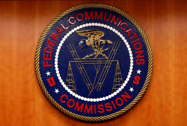 FILE PHOTO: The Federal Communications Commission (FCC) logo is seen in Washington February 26, 2015. REUTERS/Yuri Gripas/File Photo