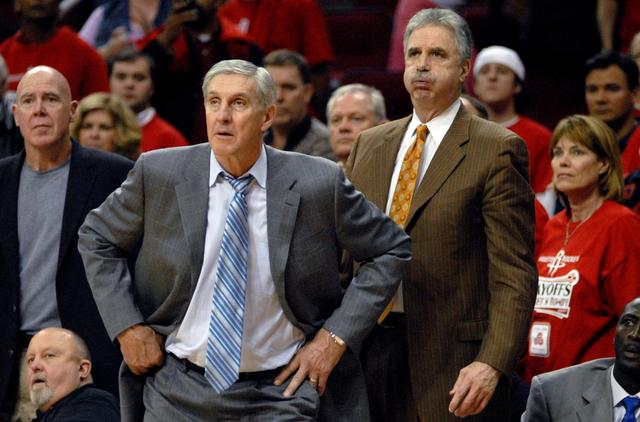 FILE PHOTO:  Utah Jazz head coach Jerry Sloan (C) and assistant coaches Mark McKown (L) and Phil Johnson (R) watch the final moments of their loss to the Houston Rockets in the second game of the first round NBA Western Conference basketball playoffs in Houston April 23, 2007. REUTERS/Tim Johnson/File Photo