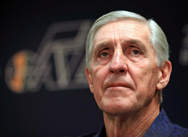 FILE PHOTO:  Former Utah Jazz head coach Jerry Sloan answers questions from the media after announcing his resignation from the Jazz in Salt Lake City, Utah, February 10, 2011. REUTERS/Michael Brandy/File Photo