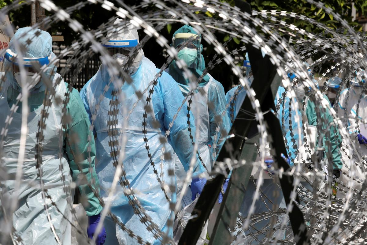 Malaysia says second virus cluster breaks out at migrant detention centers