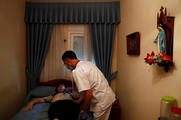Little fear, lots of love as Madrid medics do home rounds amid pandemic