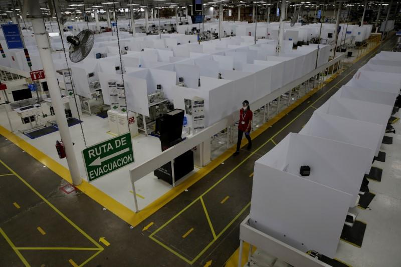Workers nervously eye return to Lear's coronavirus-hit plant in Mexico