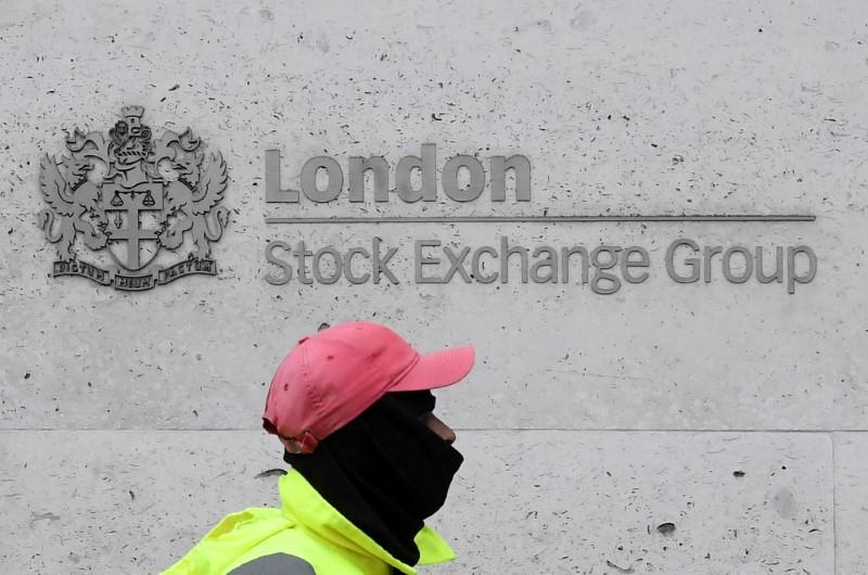 London stocks surge as recovery optimism buoyed by robust data