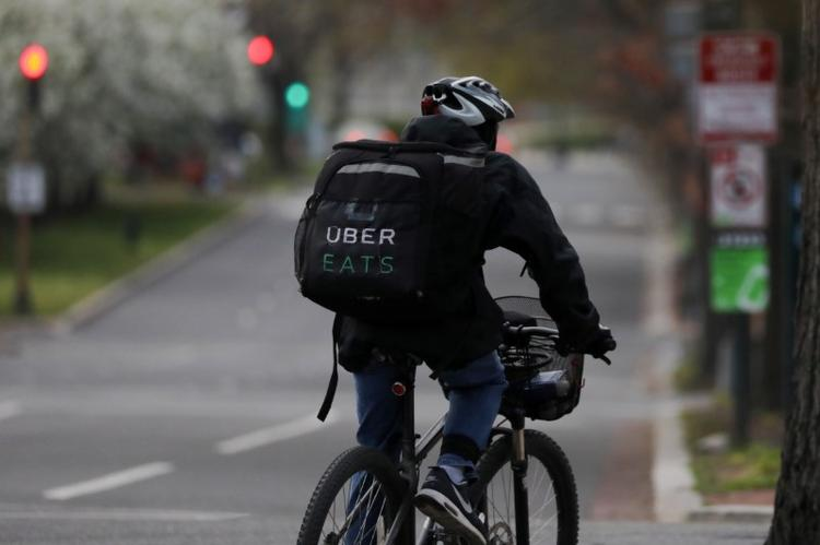 UPDATE 1-Uber Eats features black-owned restaurants on U.S., Canadian delivery platform