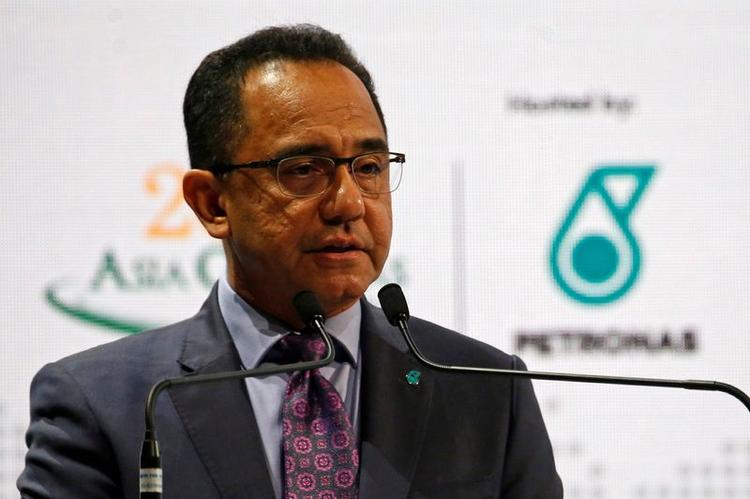 UPDATE 3-Malaysian prime minister names Petronas finance chief as new CEO
