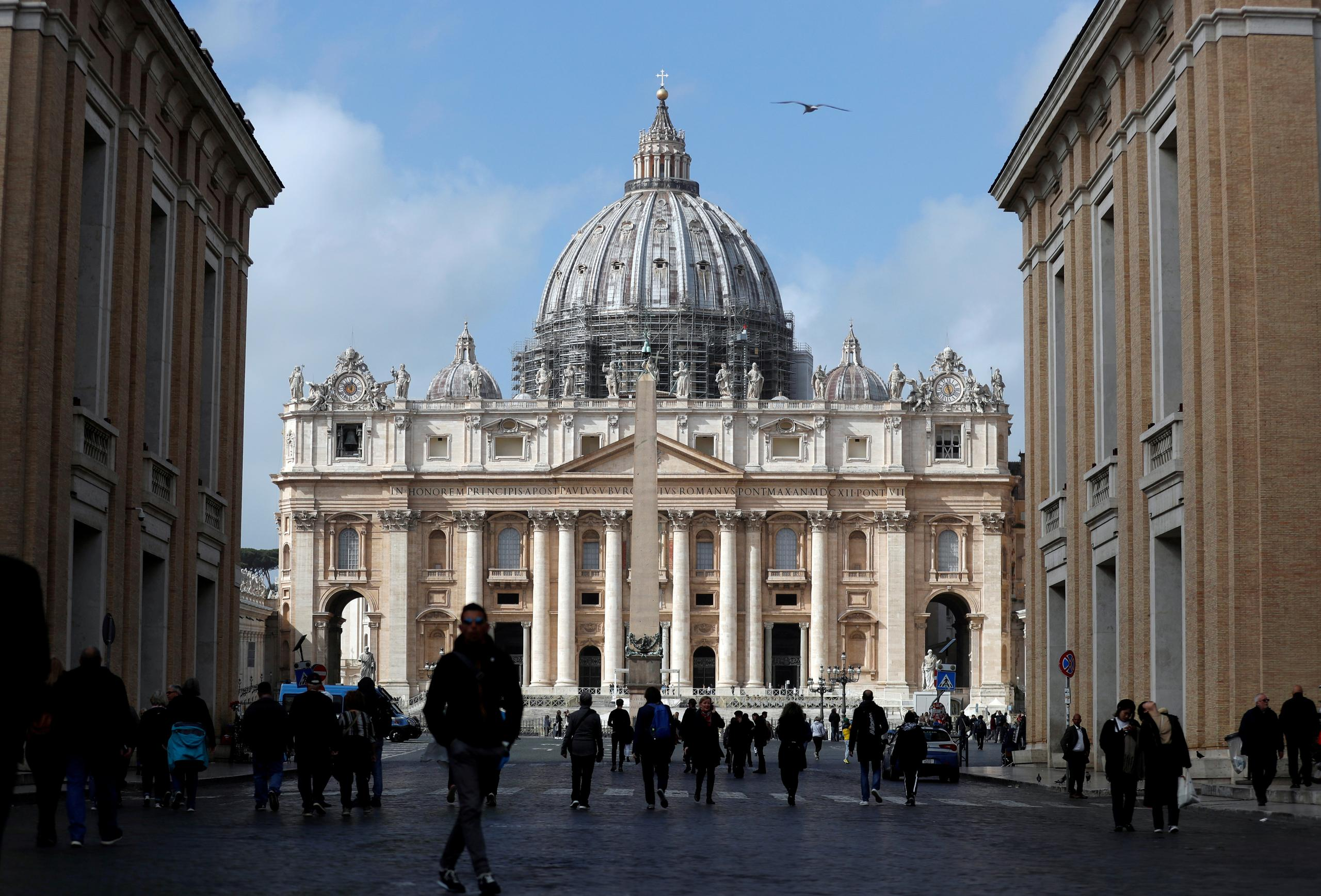 FILE PHOTO: People walk on St. Peter's Square after the Vatican reports its first case of coronavirus, at the Vatican, March 6, 2020. REUTERS/Yara Nardi