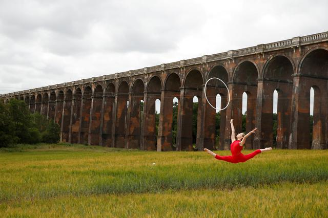 Former Team GB rhythmic gymnast Hannah Martin trains at Ouse Valley Viaduct in Sussex, Britain, June 29, 2020. REUTERS/Matthew Childs