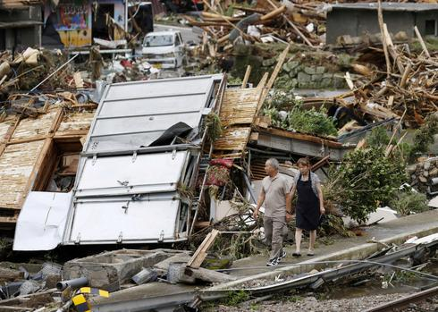 Torrential rain turns Japanese streets to rivers