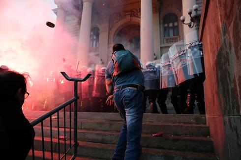 Demonstrators storm Serbian parliament in protest over lockdown