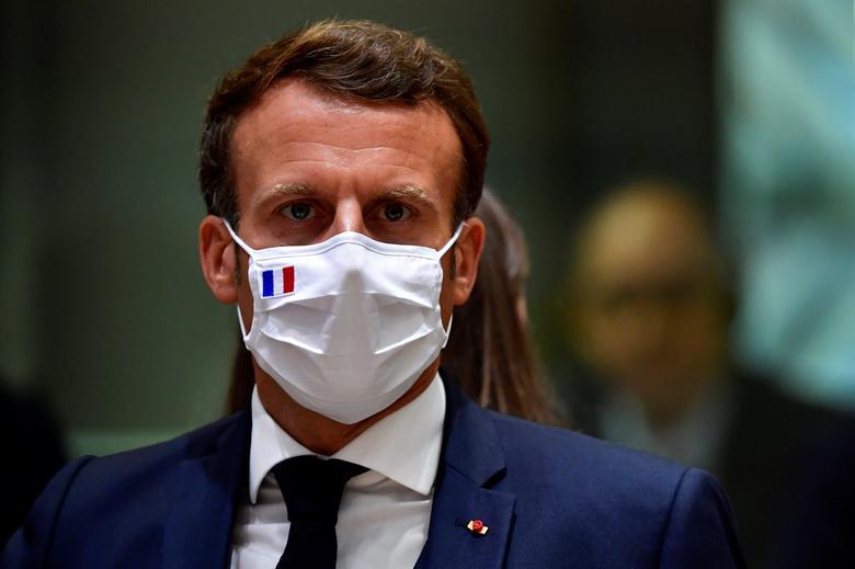 France's President Emmanuel Macron looks on during the EU summit in Brussels, Belgium, July <span dir=