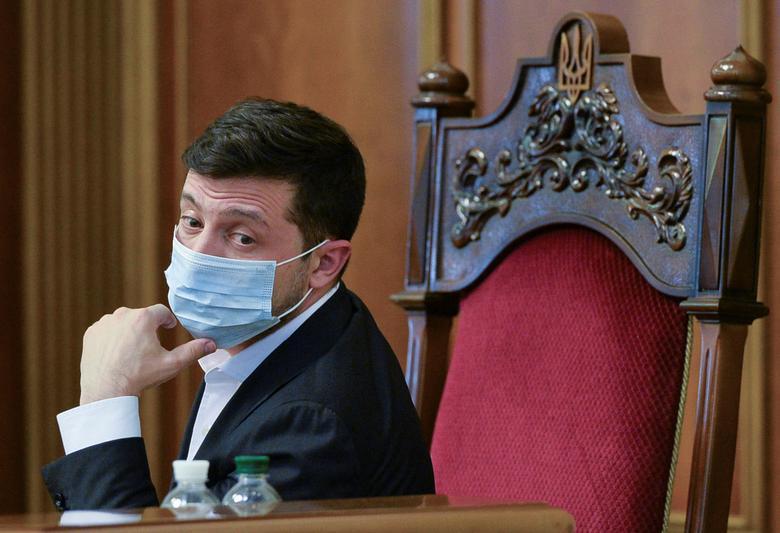Ukrainian President Volodymyr Zelenskiy attends a session of parliament in Kiev, March <span dir=