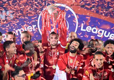 Liverpool celebrate Premier League title in empty Kop