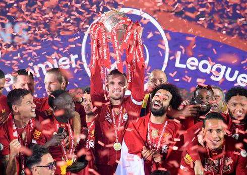 Liverpool celebrate Premier League title in empty Kop