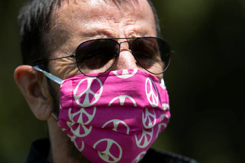 Musician Ringo Starr wears a face mask as he poses while celebrating his 80th birthday in Beverly Hills, California, July 7, <span dir=