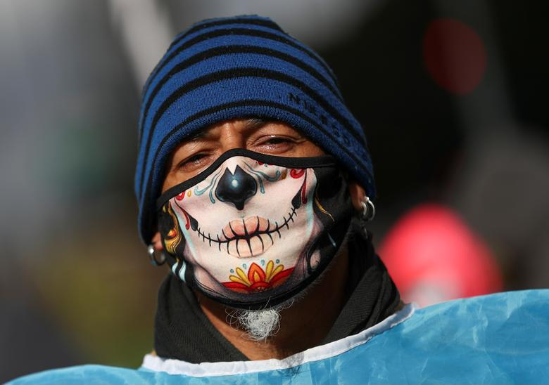 A demonstrator wearing a face mask is seen during a protest to demand resources for the vulnerable in Buenos Aires, Argentina July 24, <span dir=