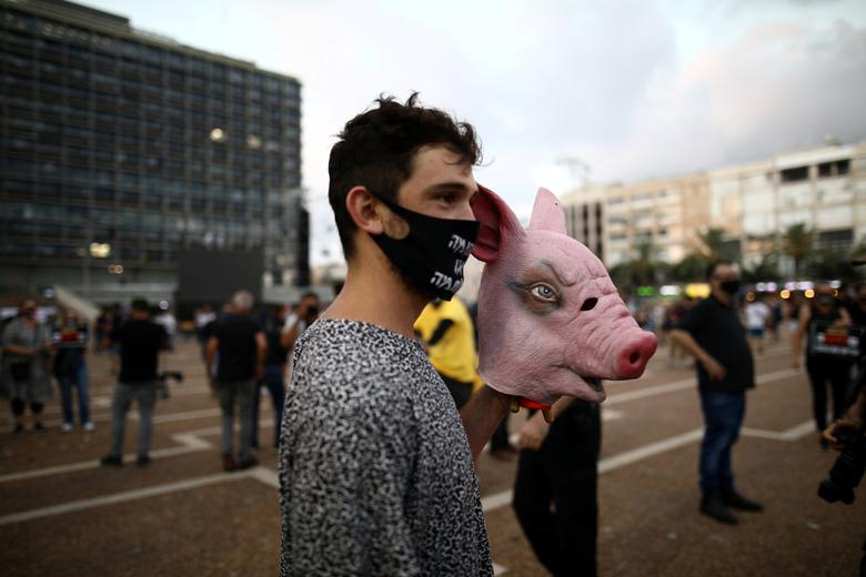 Israelis protest against the government's response to the financial fallout of the coronavirus crisis at Rabin square in Tel Aviv, Israel July 11, <span dir=