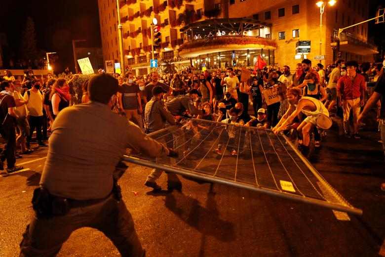 Police clash with people as they protest against Israeli Prime Minister Benjamin Netanyahu and his government's response to the financial fallout of the coronavirus crisis outside Prime Minister Benjamin Netanyahu's residence in Jerusalem July 15, <span dir=