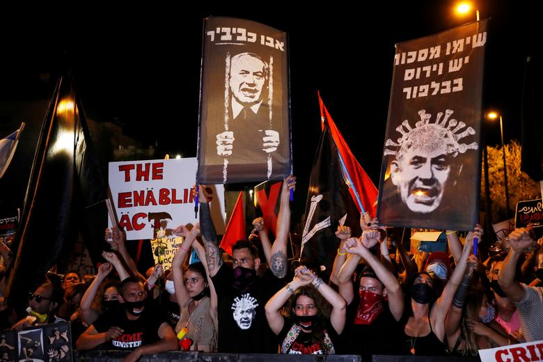 Israelis protest against Israeli Prime Minister Benjamin Netanyahu and his government's response to the financial fallout of the coronavirus crisis outside Netanyahu's residence in Jerusalem July 21, <span dir=