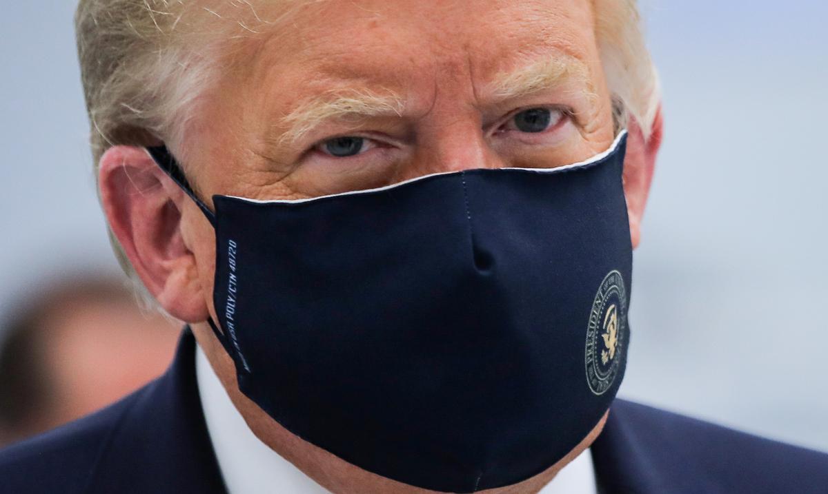 Trump wears mask, voices hope on coronavirus vaccine in North Carolina - Reuters