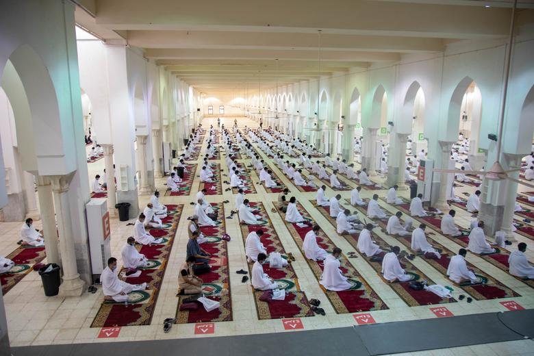A general view shows Muslim pilgrims wearing protective masks and maintaining social distancing as they pray inside Namira Mosque in Arafat to mark Haj's most important day, Day of Arafat, July 30, <span dir=