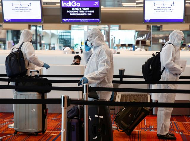 Singapore to make travellers wear electronic tags to enforce quarantine | Reuters