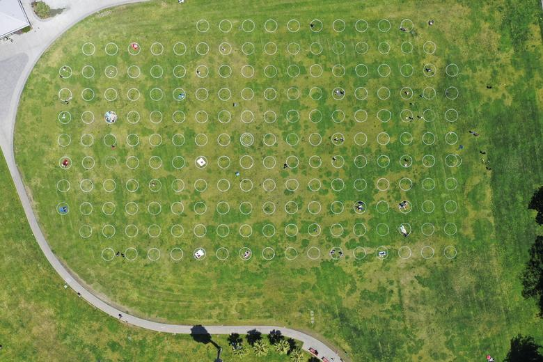 Sunbathers lie in circles marked on the grass to aid in social distancing at Mission Dolores Park in San Francisco, California, May 21. REUTERS/Drone Base