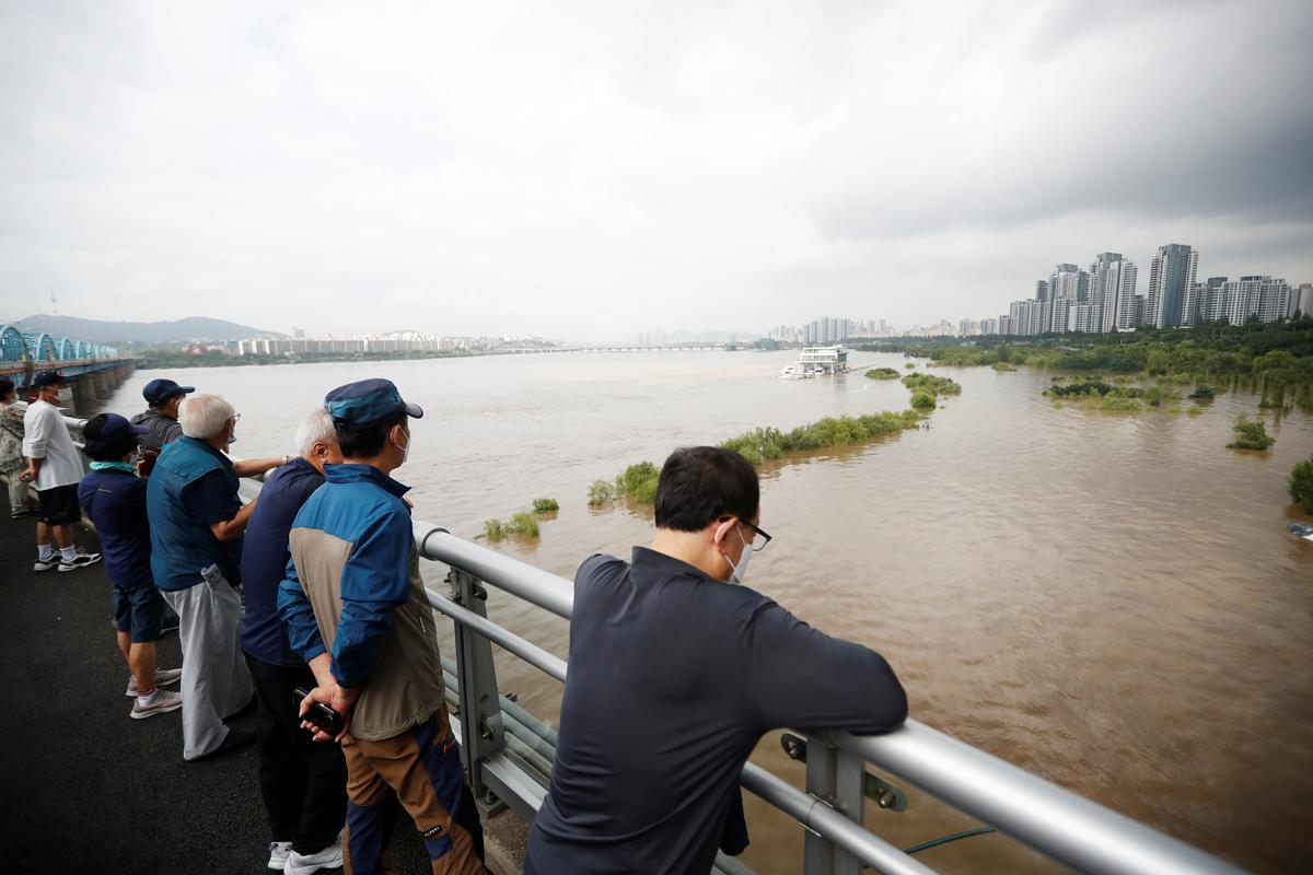 South Korea searches for rescue workers missing in floods