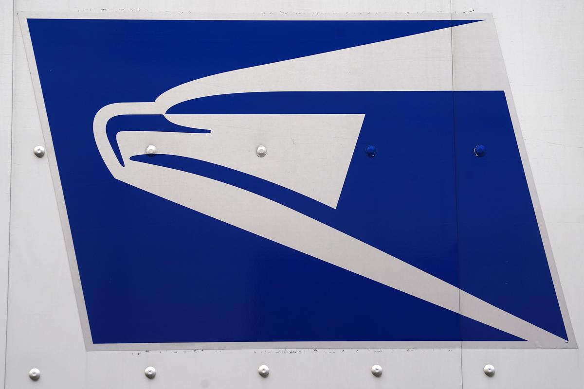 U.S. Postal Service chief warns of 'dire' finances, adopts manager hiring freeze
