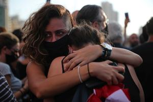 Beirut residents grieve at candlelit vigil