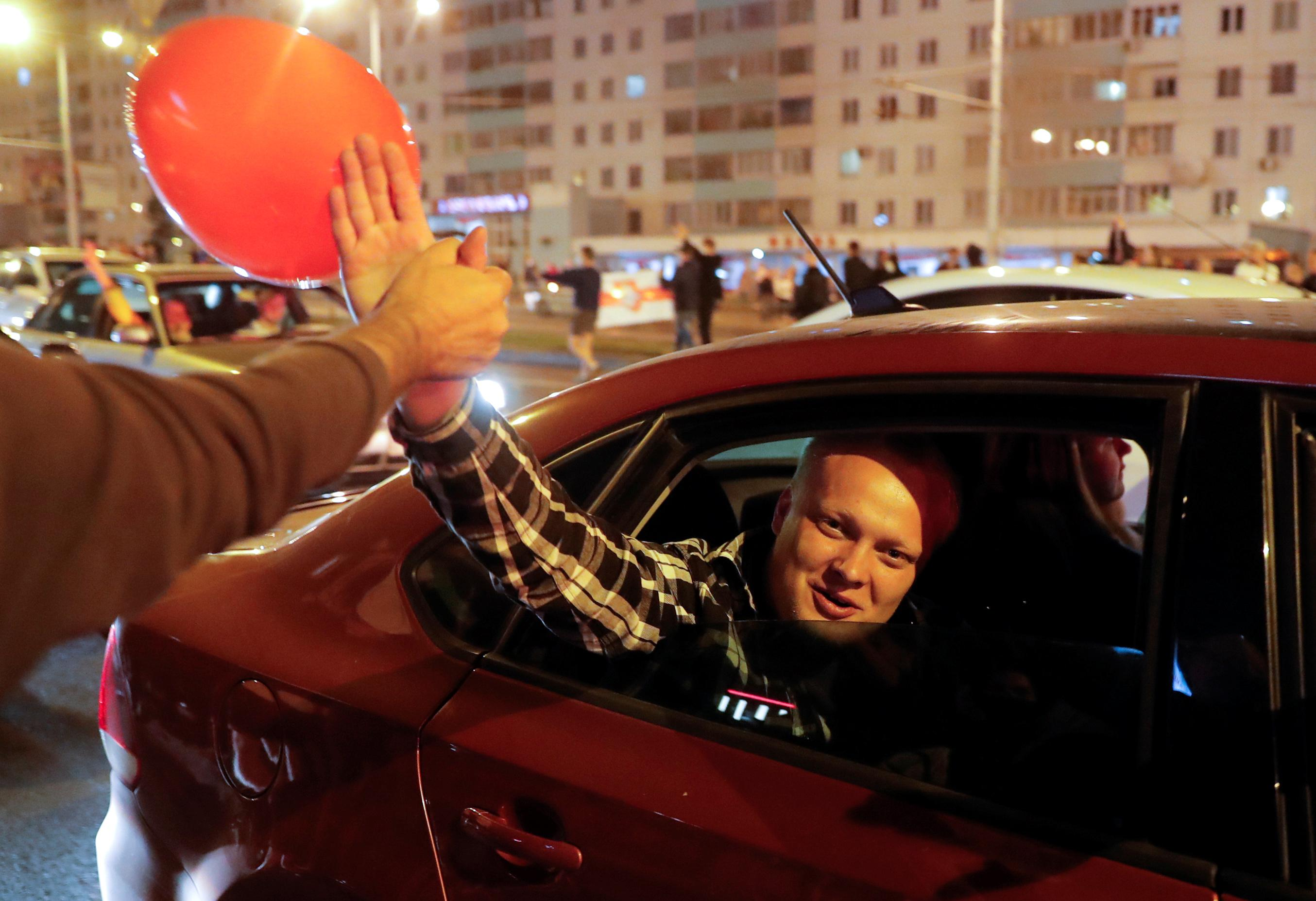 'We don't need war': Belarus leadership says sorry in bid to quell protests