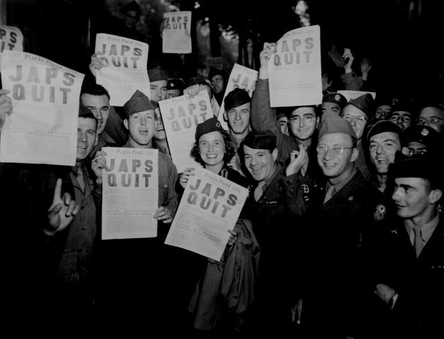 G.I.\u0027s celebrate the surrender of Japan with a special edition of the Paris Post, in Paris, France, August 10, 1945. U.S. National Archives/via REUTERS