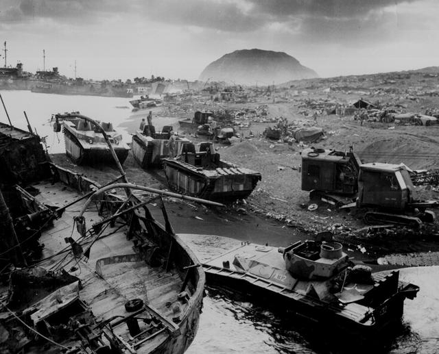 U.S. vehicles knocked out by Japanese resistance on the black sands of Iwo Jima, March 1945. U.S. National Archives/via REUTERS