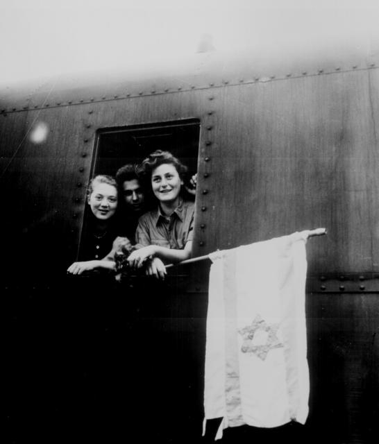 Jewish children on their way to Palestine after having been released from the Buchenwald Concentration Camp, June 5, 1945. The girl on the left is from Poland, the boy in the center from Latvia, and the girl on right from Hungary. U.S. National Archives/via REUTERS