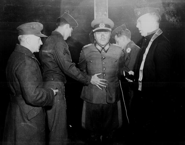 German General Anton Dostler is tied to a stake before his execution by a firing squad in the Aversa stockade, Aversa, Italy, December 1, 1945. The General was convicted and sentenced to death by an American military tribunal. U.S. National Archives/via REUTERS