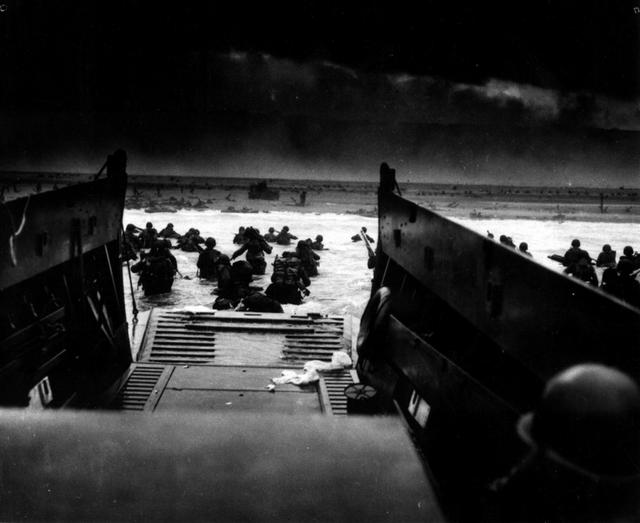 U.S. soldiers land on the coast of France under heavy machine gun fire, June 6, 1944. U.S. National Archives/via REUTERS