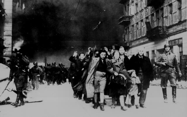 Jewish civilians are led down a street by German soldiers during the destruction of the Warsaw Ghetto, in Poland, 1943.   U.S. National Archives/via REUTERS