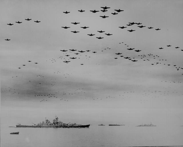 U.S. F4U and F6F planes fly in formation during surrender ceremonies aboard the USS Missouri, off Japan, September 2, 1945. U.S. National Archives/via REUTERS