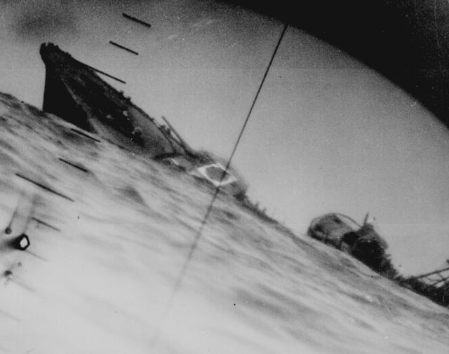 A torpedoed Japanese destroyer photographed through the periscope of the U.S.S. Wahoo or U.S.S. Nautilus, June 1942. U.S. National Archives/via REUTERS