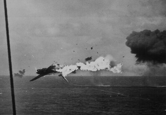 A Japanese plane is shot down as it attempts to attack the USS Kitkun Bay near the Mariana Islands, June 1944. U.S. National Archives/via REUTERS