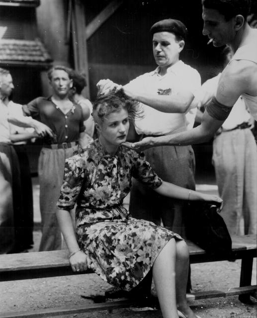 A woman has her head shaved following the retreat of German forces from the Montelimar area of France, August 29, 1944. U.S. National Archives/via REUTERS
